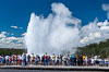 A crowd gathers to watch the worlds most famous geyser, Old Faithful, in Yellowstone National Park. Upper Geyser Basin, Wyoming, USA