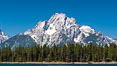 Mount Moran in the Teton Range rises above Jackson Lake, summer. Jackson Lake, Grand Teton National Park, Wyoming, USA. Image #07768