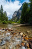 The South Fork of the Kings River flows through Kings Canyon National Park, in the southeastern Sierra mountain range. Grand Sentinel, a huge granite monolith, is visible on the right above pine trees. Late summer. Sequoia Kings Canyon National Park, California, USA. Image #09854