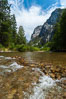 The South Fork of the Kings River flows through Kings Canyon National Park, in the southeastern Sierra mountain range. Grand Sentinel, a huge granite monolith, is visible on the right above pine trees. Late summer. Sequoia Kings Canyon National Park, California, USA. Image #09856