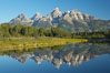 The Teton Range is reflected in the glassy waters of the Snake River at Schwabacher Landing. Grand Teton National Park, Wyoming, USA. Image #12982