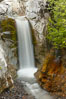 Christine Falls is a 69 foot (21m) waterfall in Mount Rainier.  The lower section of Christine Falls is  known for the bridge that spans across it. Christine Falls, Mount Rainier National Park, Washington, USA. Image #13823