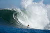 2006 Mavericks surf contest champion Grant Twiggy Baker of South Africa catches one of his many great waves of the day, this one in the first round.  Check out the huge bounce lifting up behind him, heavy.  Mavericks surf contest, February 7, 2006. Mavericks, Half Moon Bay, California, USA. Image #15307