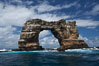 Darwins Arch, a dramatic 50-foot tall natural lava arch, rises above the ocean a short distance offshore of Darwin Island. Galapagos Islands, Ecuador