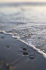 Beach stones, sea water, sand, reflections of sunset. Ponto, Carlsbad, California, USA. Image #17986