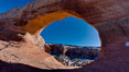 Wilson Arch rises high above route 191 in eastern Utah, with a span of 91 feet and a height of 46 feet. Wilson Arch, Utah, USA. Image #18035