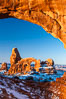 Sunrise light on Turret Arch viewed through North Window, winter. North Window, Arches National Park, Utah, Utah, USA. Image #18119