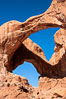 Double Arch, an amazing pair of natural arches formed in the red Entrada sandstone of Arches National Park. Double Arch, Arches National Park, Utah, Utah, USA. Image #18177