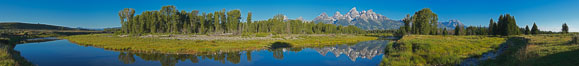 Panorama of the Teton Range reflected in the still waters of Schwabacher Landing, a sidewater of the Snake River. Grand Teton National Park, Wyoming, USA. Image #19129