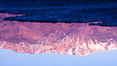 Sunrise lights Telescope Peak as it rises over the salt flats of Badwater, Death Valley.  At 11,049 feet, Telescope Peak is the highest peak in the Panamint Range as well as the highest point in Death Valley National Park.  At 282 feet below sea level, Badwater is the lowest point in North America. Badwater, Death Valley National Park, California, USA. Image #20550