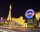 Half-scale replica of the Eiffel Tower rises above Las Vegas Boulevard, the Strip, in front of the Paris Hotel. Las Vegas, Nevada, USA. Image #20558