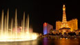 The Bellagio Hotel fountains light up the reflection pool as the half-scale replica of the Eiffel Tower at the Paris Hotel in Las Vegas rises above them, at night. Las Vegas, Nevada, USA. Image #20560