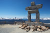 Ilanaaq, the logo of the 2010 Winter Olympics in Vancouver, is formed of stone in the Inukshuk-style of traditional Inuit sculpture.  This one is located on the summit of Whistler Mountain. Whistler, British Columbia, Canada. Image #21014