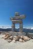 Ilanaaq, the logo of the 2010 Winter Olympics in Vancouver, is formed of stone in the Inukshuk-style of traditional Inuit sculpture.  This one is located on the summit of Whistler Mountain. Whistler, British Columbia, Canada. Image #21015