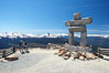Ilanaaq, the logo of the 2010 Winter Olympics in Vancouver, is formed of stone in the Inukshuk-style of traditional Inuit sculpture.  This one is located on the summit of Whistler Mountain. British Columbia, Canada. Image #21018