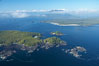 Blunden Island (foreground) and Vargas Island (distance), surrounded by the waters of Clayoquot Sound, west coast of Vancouver Island. Tofino, British Columbia, Canada. Image #21069