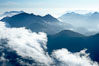 Coastal mountains and clouds, rising above Bedwell Sound (hidden by clouds) and Clayoquot Sound, near Tofino on the west coast of Vancouver Island. British Columbia, Canada. Image #21093
