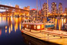 Yaletown section of Vancouver at night, including Granville Island bridge (left), viewed from Granville Island with sailboat in the foreground. British Columbia, Canada. Image #21169