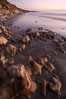 Rocks, sand, ocean and sea cliffs, sunset. Carlsbad, California, USA. Image #22199