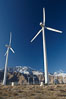 Wind turbines, rise above the flat floor of the San Gorgonio Pass near Palm Springs, with snow covered Mount San Jacinto in the background, provide electricity to Palm Springs and the Coachella Valley. San Gorgonio Pass, Palm Springs, California, USA. Image #22207
