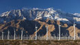Wind turbines and Mount San Jacinto, rise above the flat floor of the San Gorgonio Pass near Palm Springs, provide electricity to Palm Springs and the Coachella Valley. San Gorgonio Pass, Palm Springs, California, USA. Image #22240