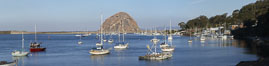 Morro Bay, boats and Morro Rock in the distance. Morro Bay, California, USA. Image #22246