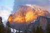 Half Dome and storm clouds at sunset, viewed from Sentinel Bridge. Half Dome, Yosemite National Park, California, USA. Image #22744