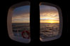 Sunset viewed through the window of my cabin on the M/V Polar Star, somewhere between Falkland Islands and South Georgia Island. Southern Ocean. Image #24097