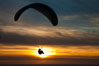 Paraglider soaring at Torrey Pines Gliderport, sunset, flying over the Pacific Ocean. La Jolla, California, USA. Image #24286