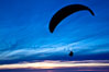 Paraglider soaring at Torrey Pines Gliderport, sunset, flying over the Pacific Ocean. La Jolla, California, USA. Image #24289