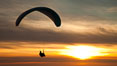 Paraglider soaring at Torrey Pines Gliderport, sunset, flying over the Pacific Ocean. La Jolla, California, USA. Image #24292