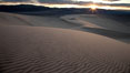 "Sunset on the Eureka Dunes.  The Eureka Valley Sand Dunes are California's tallest sand dunes, and one of the tallest in the United States.  Rising 680' above the floor of the Eureka Valley, the Eureka sand dunes are home to several endangered species, as well as ""singing sand"" that makes strange sounds when it shifts.  Located in the remote northern portion of Death Valley National Park, the Eureka Dunes see very few visitors. Eureka Dunes, Death Valley National Park, California, USA. Image #25240"