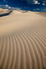"Eureka Dunes.  The Eureka Valley Sand Dunes are California's tallest sand dunes, and one of the tallest in the United States.  Rising 680' above the floor of the Eureka Valley, the Eureka sand dunes are home to several endangered species, as well as ""singing sand"" that makes strange sounds when it shifts.  Located in the remote northern portion of Death Valley National Park, the Eureka Dunes see very few visitors. Eureka Dunes, Death Valley National Park, California, USA. Image #25250"