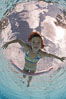Young girl swimming in a pool. Image #25288