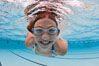 Young girl swimming in a pool. Image #25290