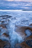 Waves wash over sandstone reef, clouds and sky. La Jolla, California, USA. Image #26335