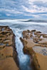 Waves wash over sandstone reef, clouds and sky. La Jolla, California, USA. Image #26336