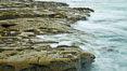 Waves wash over sandstone reef, clouds and sky. La Jolla, California, USA. Image #26345