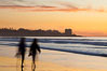 Tourists walk along La Jolla Shores beach at sunset.  Point La Jolla is visible in the distance. Scripps Institution of Oceanography, California, USA. Image #26533