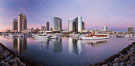 Panoramic photo of San Diego embarcadero, showing the San Diego Marriott Hotel and Marina (center), Roy's Restaurant (center) and Manchester Grand Hyatt Hotel (left) viewed from the San Diego Embarcadero Marine Park. California, USA. Image #26566