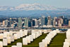 Tombstones at Fort Rosecrans National Cemetery, with downtown San Diego with snow-covered Mt. Laguna in the distance. California, USA. Image #26593