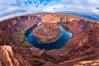 Horseshoe Bend. The Colorado River makes a 180-degree turn at Horseshoe Bend. Here the river has eroded the Navajo sandstone for eons, digging a canyon 1100-feet deep. Horseshoe Bend, Page, Arizona, USA. Image #26602