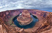 Horseshoe Bend. The Colorado River makes a 180-degree turn at Horseshoe Bend. Here the river has eroded the Navajo sandstone for eons, digging a canyon 1100-feet deep. Horseshoe Bend, Page, Arizona, USA. Image #26617