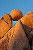 Boulders and sunset in Joshua Tree National Park.  The warm sunlight gently lights unusual boulder formations at Jumbo Rocks in Joshua Tree National Park, California. Joshua Tree National Park, California, USA. Image #26726
