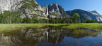 Yosemite Falls reflected in flooded meadow.  The Merced  River floods its banks in spring, forming beautiful reflections of Yosemite Falls. Yosemite National Park, California, USA. Image #26887