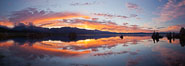 Mono Lake sunset, Sierra Nevada mountain range and tufas, clouds reflected in the still waters of Mono Lake. Mono Lake, California, USA. Image #26968