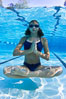 Athletic young girl underwater, performing isometric exercises. Image #27055
