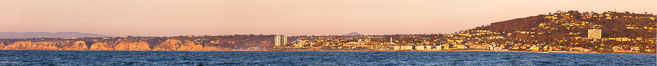 Panorama of La Jolla, with Mount Soledad aglow at sunset, viewed from the Pacific Ocean offshore of San Diego. La Jolla, California, USA. Image #27085