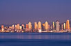 San Diego downtown city skyline and waterfront, sunset reflections and San Diego Bay. Earth-shadow (Belt of Venus) visible in the atmosphere. San Diego, California, USA. Image #27103
