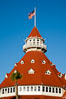 Hotel del Coronado, known affectionately as the Hotel Del. It was once the largest hotel in the world, and is one of the few remaining wooden Victorian beach resorts. It sits on the beach on Coronado Island, seen here with downtown San Diego in the distance. It is widely considered to be one of Americas most beautiful and classic hotels. Built in 1888, it was designated a National Historic Landmark in 1977. San Diego, California, USA. Image #27107
